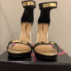 Black and gold open toe stilettos